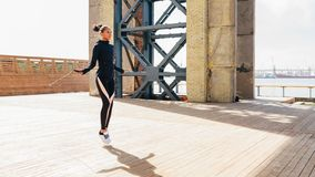 Female athlete skipping with jumping rope. Outdoors Stock Photography
