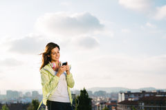 Female athlete with smartphone messaging Royalty Free Stock Photos