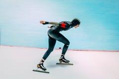 Female athlete speed skaters track runs Royalty Free Stock Image