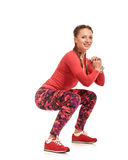 Female athlete squating Royalty Free Stock Photos