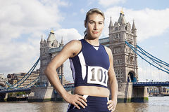 Female Athlete standing in front of Tower Bridge Royalty Free Stock Photo