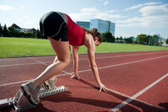 Female athlete in the starting blocks Royalty Free Stock Photography