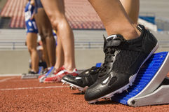 Female Athlete On Starting Blocks stock photos