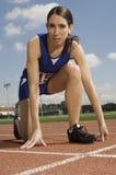 Female Athlete At Starting Line Stock Photo