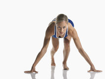 Female Athlete In Starting Position Royalty Free Stock Photos