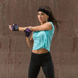 Female athlete stretching her arm. Young woman doing warm-up exercises before running. Royalty Free Stock Photo