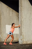 Female athlete stretching legs for running Stock Images