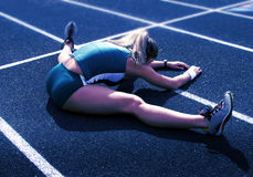 Female Athlete Stretching on Track Stock Photography