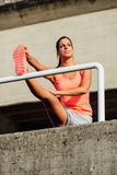 Female athlete stretching for warming up Royalty Free Stock Photo