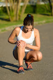 Female athlete suffering knee joint  sport injury Royalty Free Stock Photography