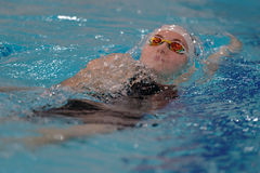 Female athlete in swimming competitions Stock Images