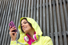 Female athlete texting message on smartphone Stock Images