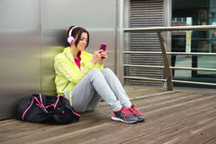 Female athlete texting message on smartphone Stock Photography