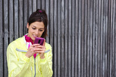 Female athlete texting message on smartphone Royalty Free Stock Photo