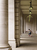 Female Athlete Throwing Discus In Portico Stock Images