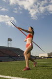 Female Athlete Throwing A Javelin Stock Image