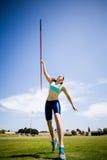 Female athlete throwing a javelin Royalty Free Stock Photos