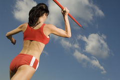 Female Athlete Throwing Javelin Against Sky Royalty Free Stock Photography