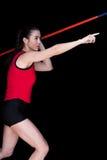 Female athlete throwing a javelin. On black background Stock Photos