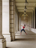 Female Athlete Throwing Javelin In Portico Stock Photography