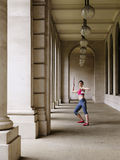 Female Athlete Throwing Javelin In Portico Royalty Free Stock Images