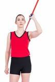 Female athlete throwing a javelin. On white background Royalty Free Stock Photo