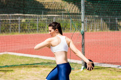 Female athlete about to throw a discus Stock Images