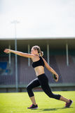Female athlete about to throw a discus Stock Image