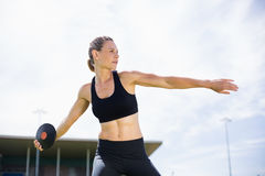 Female athlete about to throw a discus. In stadium royalty free stock photo