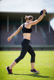 Female athlete about to throw a discus stock photo