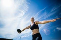 Female athlete about to throw a discus Royalty Free Stock Photos