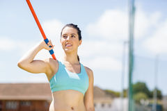 Female athlete about to throw a javelin Royalty Free Stock Photo