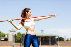 Female athlete about to throw a javelin Stock Image
