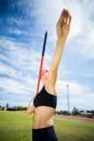 Female athlete about to throw a javelin Royalty Free Stock Photos