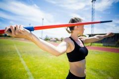 Female athlete about to throw a javelin Stock Photos