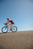 Female athlete training for cycling event of a triathlon Stock Photo