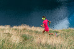Female athlete trains in a mountain meadow stock photography