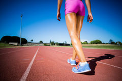 Female athlete walking on the racing track Stock Photo