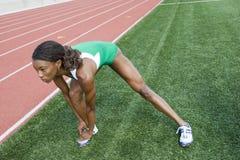 Female Athlete Warming Up Stock Photography