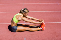 Female athlete warming up on the running track Stock Images