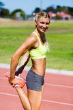 Female athlete warming up on the running track Stock Photography