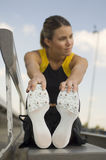 Female Athlete Warming Up In Stadium Stock Image