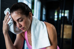 Female athlete wiping sweat. In gym Royalty Free Stock Image