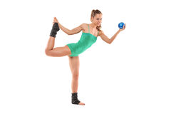 A female athlete working out with a ball Stock Photo