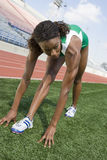 Female Athlete Working Out On Field Royalty Free Stock Photography
