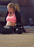 Female Athlete on a Workout Break Stock Images