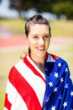 Female athlete wrapped in american flag Stock Photo