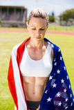 Female athlete wrapped in american flag Royalty Free Stock Image