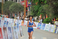 Female athletes in the marathon. A female athlete in the marathon.Half international marathon in fushui county in yunnan province in China, time: on September 25 Royalty Free Stock Images