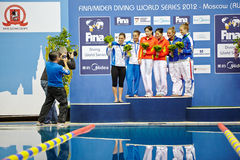 Female athletes-medalists are pfotographed Royalty Free Stock Images